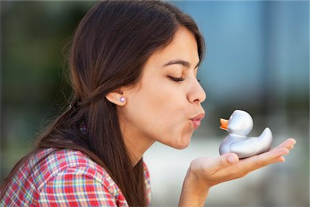 Woman kissing rubber duck Stock Photo - Premium Royalty-Free, Code: 6108-05869907