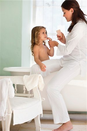 Woman giving a bath to her daughter Stock Photo - Premium Royalty-Free, Code: 6108-05870181