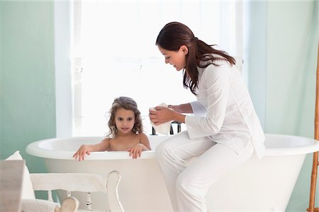 Woman giving a bath to her daughter Stock Photo - Premium Royalty-Free, Code: 6108-05870188
