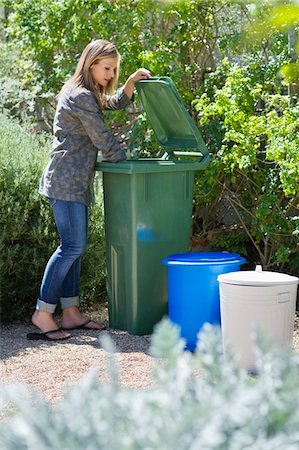 Woman looking into recycling bin Stock Photo - Premium Royalty-Free, Code: 6108-05870284