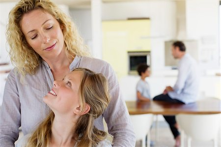 Girl looking at her mother and smiling Stock Photo - Premium Royalty-Free, Code: 6108-05870353