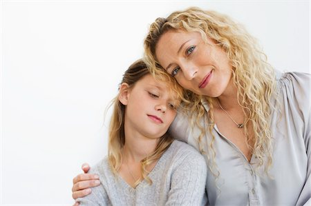 preteen girl - Portrait of a mid adult woman sitting with her daughter Stock Photo - Premium Royalty-Free, Code: 6108-05870403
