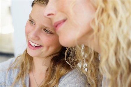 Close-up of happy daughter sitting with mother Stock Photo - Premium Royalty-Free, Code: 6108-05870423