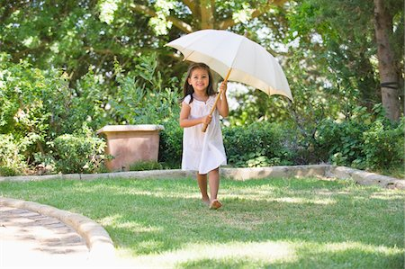 Cute little girl holding an umbrella Stock Photo - Premium Royalty-Free, Code: 6108-05870683