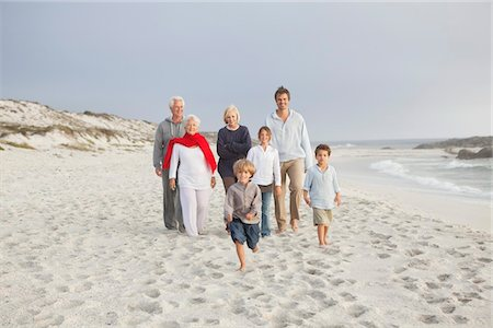 Family enjoying on the beach Stock Photo - Premium Royalty-Free, Code: 6108-05870817