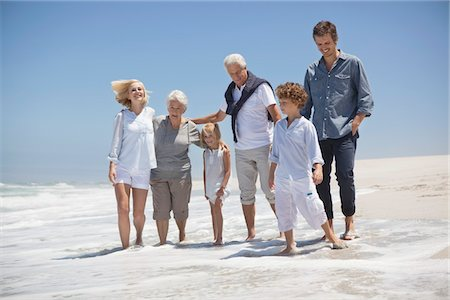 Family enjoying on the beach Stock Photo - Premium Royalty-Free, Code: 6108-05870820