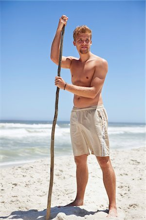 stick - Man standing on the beach with a stick Stock Photo - Premium Royalty-Free, Code: 6108-05871039