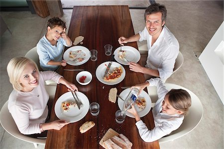 Family having food together Stock Photo - Premium Royalty-Free, Code: 6108-05871188