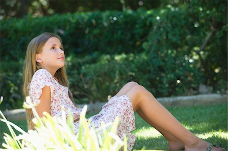 preteen beauty - Contemplative little girl looking up in garden Stock Photo - Premium Royalty-Free, Code: 6108-05871106