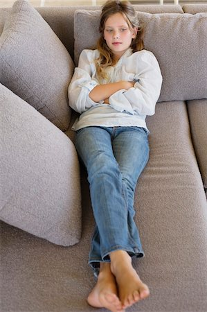 preteen beauty - High angle view of a girl lying on a couch Stock Photo - Premium Royalty-Free, Code: 6108-05871124