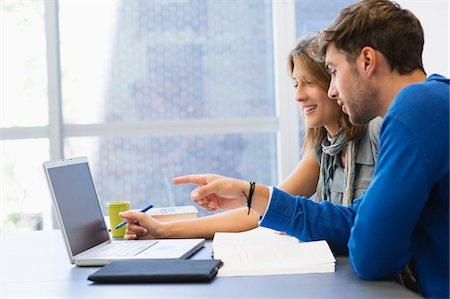 University students using laptop in classroom Stock Photo - Premium Royalty-Free, Code: 6108-05871252