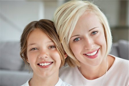 Portrait of a woman smiling with her daughter Stock Photo - Premium Royalty-Free, Code: 6108-05871217