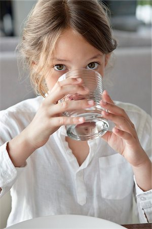 Portrait of a girl drinking water Stock Photo - Premium Royalty-Free, Code: 6108-05871218