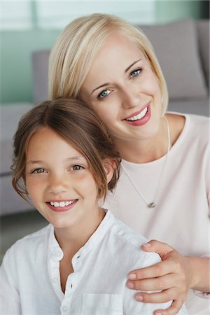 Portrait of a woman smiling with her daughter Stock Photo - Premium Royalty-Free, Code: 6108-05871225