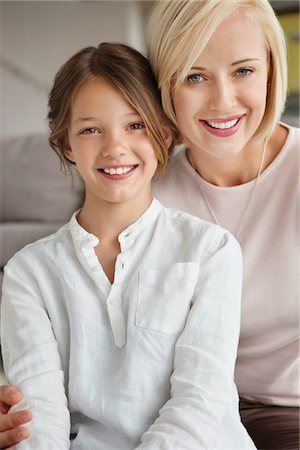 Portrait of a woman smiling with her daughter Stock Photo - Premium Royalty-Free, Code: 6108-05871229