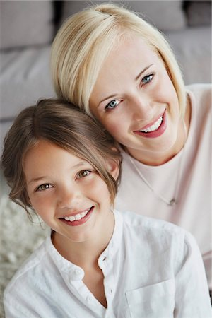 Portrait of a woman smiling with her daughter Stock Photo - Premium Royalty-Free, Code: 6108-05871239