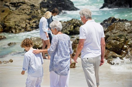 preteens pictures older men - Multi generation family collecting shell on the beach Stock Photo - Premium Royalty-Free, Code: 6108-05871546