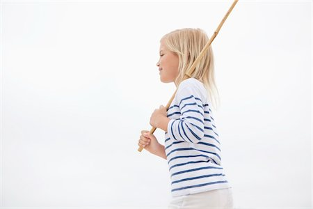 stick - Side profile of a girl holding stick Stock Photo - Premium Royalty-Free, Code: 6108-05871584