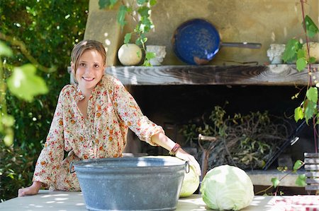 preteen girls bath - Portrait of a little girl with cabbage on table outdoors Stock Photo - Premium Royalty-Free, Code: 6108-05871774