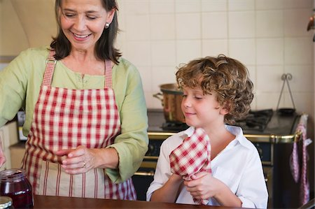 Grandmother and little boy cooking food at kitchen Stock Photo - Premium Royalty-Free, Code: 6108-05871778