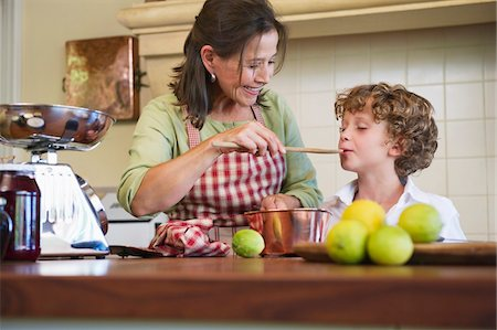 Grandmother and little boy cooking food at home Stock Photo - Premium Royalty-Free, Code: 6108-05871798