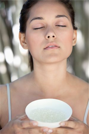 smelly - Beautiful young woman holding a bowl with bath salt Stock Photo - Premium Royalty-Free, Code: 6108-05871734