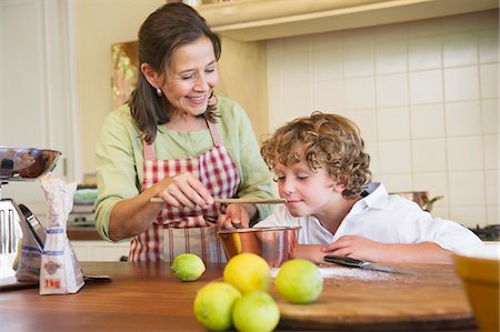 Grandmother and little boy cooking food at kitchen Stock Photo - Premium Royalty-Free, Code: 6108-05871828