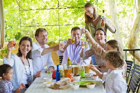 Multi generation family eating food at house Stock Photo - Premium Royalty-Free, Code: 6108-05871948