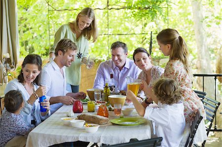 preteen girl - Multi generation family eating food at house Stock Photo - Premium Royalty-Free, Code: 6108-05871920