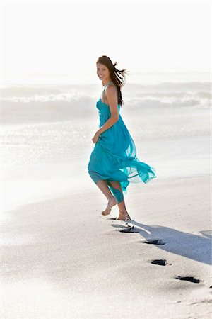 Young woman's footprint while running on a beach Stock Photo - Premium Royalty-Free, Code: 6108-05872429