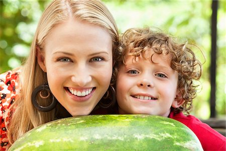 Mother and son leaning on watermelon Stock Photo - Premium Royalty-Free, Code: 6108-05872588