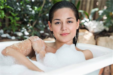 Portrait of a beautiful young woman taking bubble bath Stock Photo - Premium Royalty-Free, Code: 6108-05872743