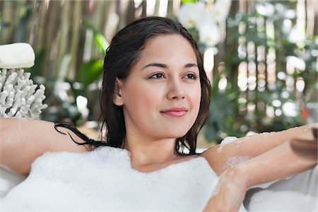 Beautiful young woman taking bubble bath Stock Photo - Premium Royalty-Free, Code: 6108-05872767