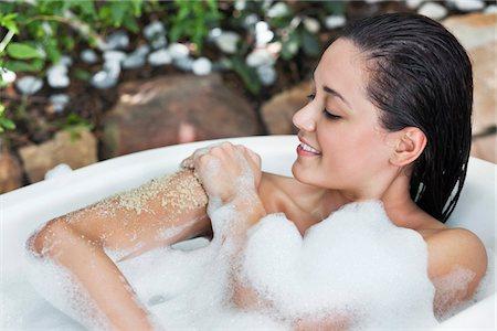 Beautiful young woman taking bubble bath Stock Photo - Premium Royalty-Free, Code: 6108-05872795