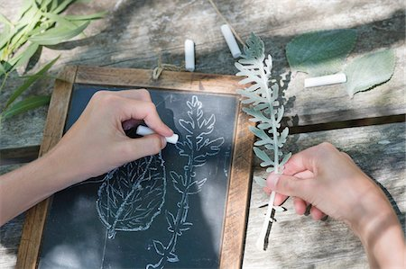 slate - Little boy making drawing of leaves on slate outdoors Stock Photo - Premium Royalty-Free, Code: 6108-05872721