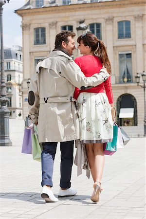 Couple walking on a street, Paris, Ile-de-France, France Stock Photo - Premium Royalty-Free, Code: 6108-05872858