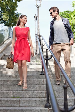 Couple moving down staircases, Montmartre, Paris, Ile-de-France, France Stock Photo - Premium Royalty-Free, Code: 6108-05872812