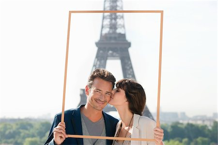 Couple framing their dream vacation with Eiffel Tower in the background, Paris, Ile-de-France, France Stock Photo - Premium Royalty-Free, Code: 6108-05872944
