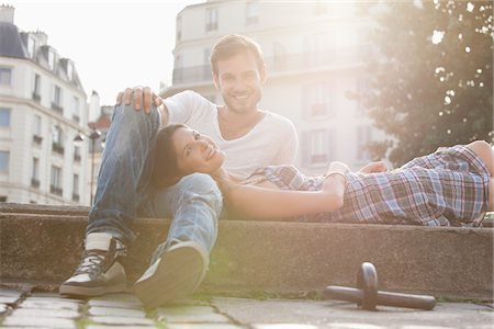 sun - Woman lying on lap of a man at the ledge of a canal, Paris, Ile-de-France, France Stock Photo - Premium Royalty-Free, Code: 6108-05872980