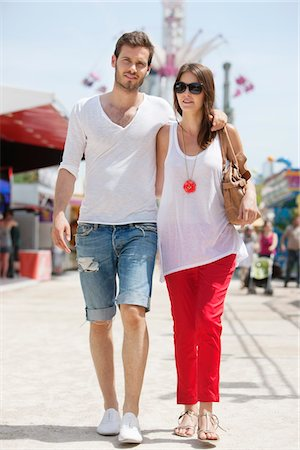 Couple walking in amusement park, Jardin des Tuileries, Paris, Ile-de-France, France Stock Photo - Premium Royalty-Free, Code: 6108-05873077