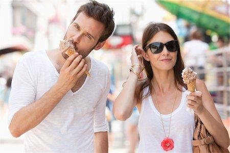 Couple eating ice creams, Paris, Ile-de-France, France Stock Photo - Premium Royalty-Free, Code: 6108-05873099