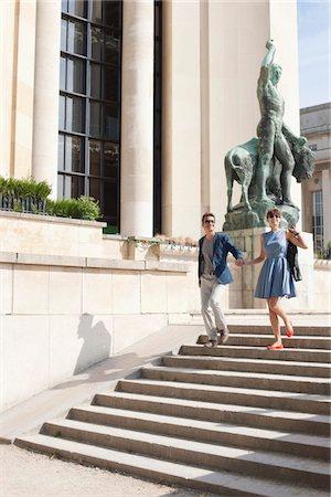 Couple moving down steps of a museum, Musee de l'Homme, Paris, Ile-de-France, France Stock Photo - Premium Royalty-Free, Code: 6108-05873141