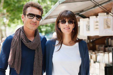 Couple smiling, Paris, Ile-de-France, France Stock Photo - Premium Royalty-Free, Code: 6108-05873164