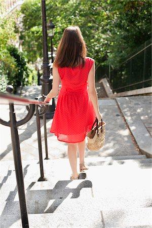 Woman moving down staircases, Montmartre, Paris, Ile-de-France, France Stock Photo - Premium Royalty-Free, Code: 6108-05873298