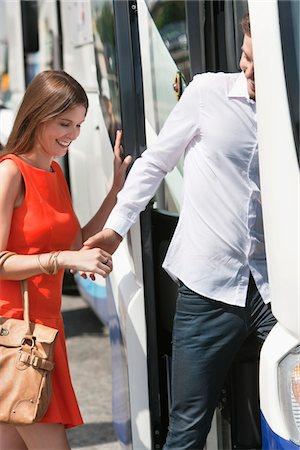 Couple boarding in a bus, Paris, Ile-de-France, France Stock Photo - Premium Royalty-Free, Code: 6108-05873212