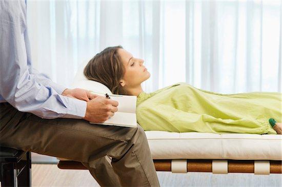 Psychiatrist examining a female patient Stock Photo - Premium Royalty-Free, Image code: 6108-05873780