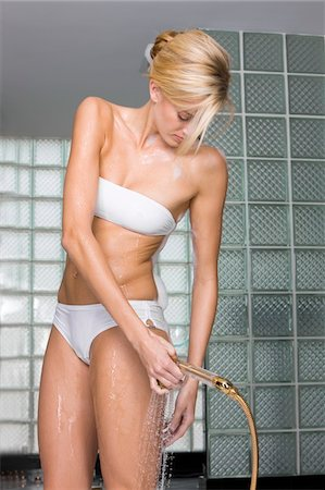 Woman taking a shower Stock Photo - Premium Royalty-Free, Code: 6108-05873868