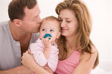 Parents loving their daughter Stock Photo - Premium Royalty-Free, Code: 6108-05874030