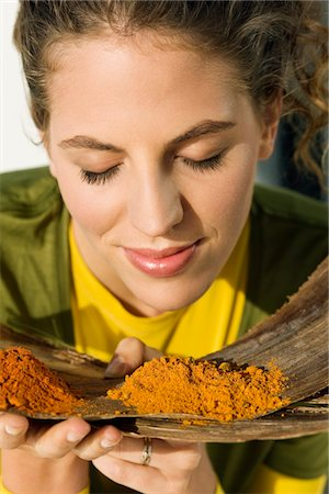 smelly - Close-up of a woman smelling spices Stock Photo - Premium Royalty-Free, Code: 6108-05874197
