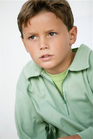 Close-up of a boy thinking Stock Photo - Premium Royalty-Free, Code: 6108-05874201